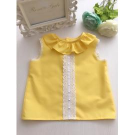 Camisa amarilla sin mangas